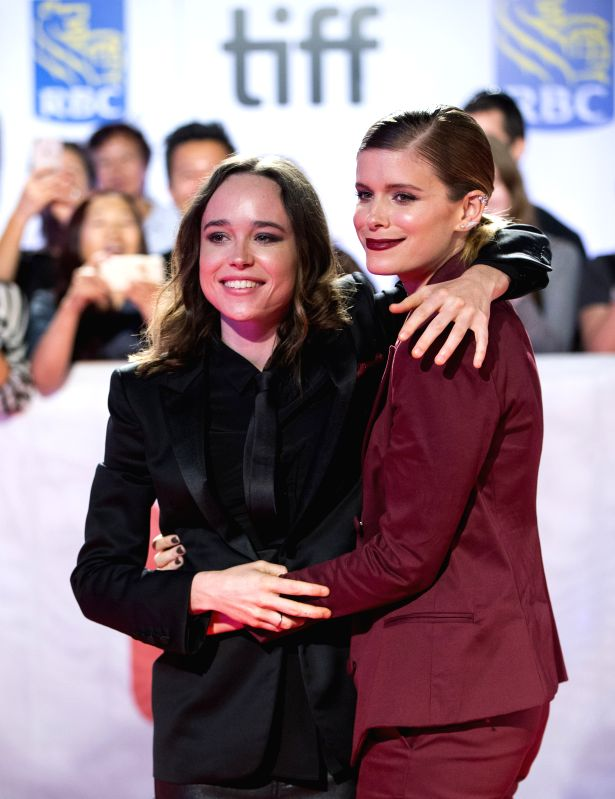 """TORONTO, Sept. 16, 2017 - Actresses Ellen Page (L) and Kate Mara pose for photos during the world premiere of the film """"My Days of Mercy"""" at Roy Thomson Hall during the 2017 Toronto ... - Ellen Page"""