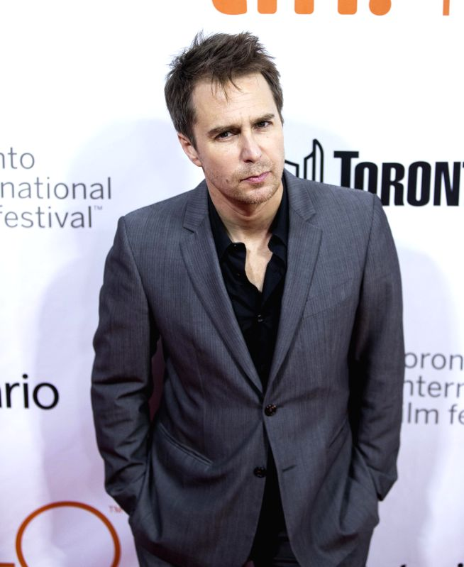 """TORONTO, Sept. 20, 2015 (Xinhua) -- Actor Sam Rockwell poses for photos before the world premiere of the closing night film """"Mr. Right"""" at Roy Thomson Hall during the 40th Toronto International Film Festival in Toronto, Canada, on Sept. 19, 2015. (Xi"""