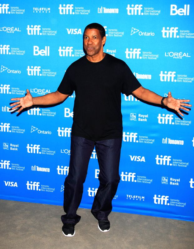 """TORONTO, Sept. 8, 2014 (Xinhua) -- Actor Denzel Washington poses for photos at the press conference of the film """"The Equalizer"""" during the 39th Toronto International Film Festival in Toronto, Canada, Sept. 7, 2014. (Xinhua/Zou Zheng/IANS)"""