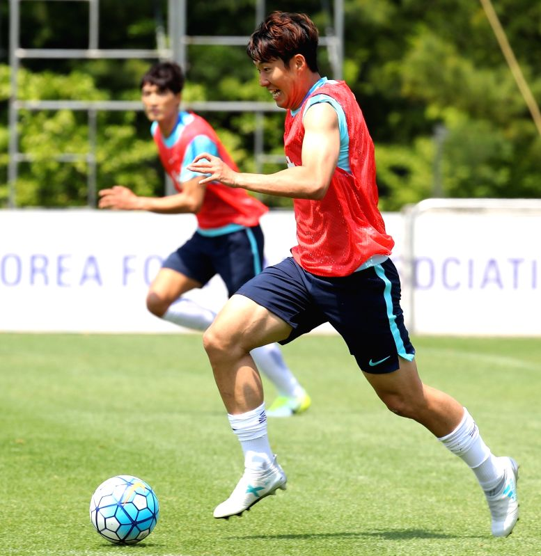 Tottenham winger Son Heung-min of South Korea dribbles the ball during a training session for an upcoming Asian preliminary for the 2018 FIFA World Cup at the National Football Center in Paju, north ...