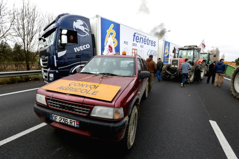 TOULOUSE, Feb. 1, 2018 - Farmers block the highway during a demonstration in Toulouse, France, Jan. 31, 2018. Farmers set up a filter dam on Wednesday to slow down traffic to protest against the ...