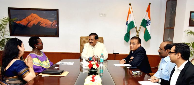 Tourism Minister of Uganda, Prof. Ephraim Kamuntu and the Honorary Consul General of Uganda, Madhusudan Agarwal call on the Union Tourism Minister Dr. Mahesh Sharma, in New Delhi on April ... - D and Mahesh Sharma