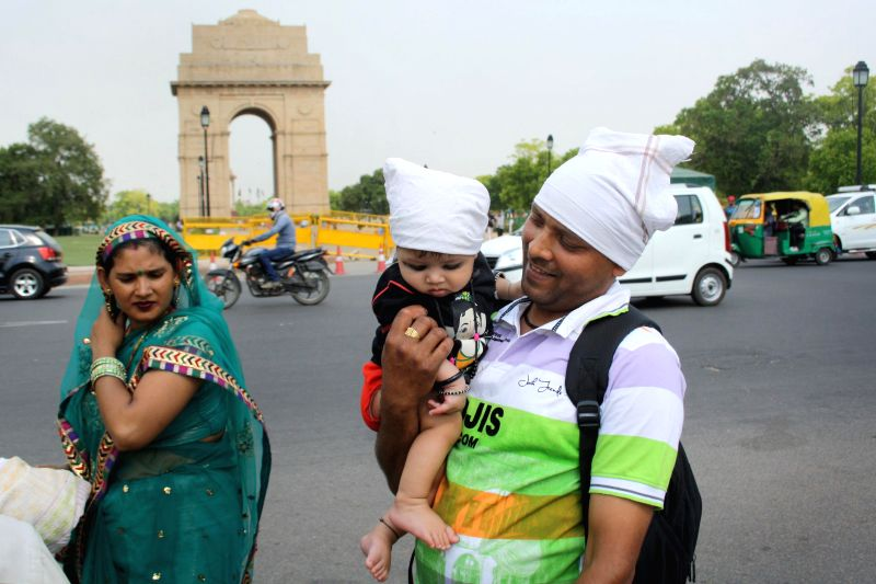 Tourists at India Gate on a hot day in in New Delhi on May 1, 2014.