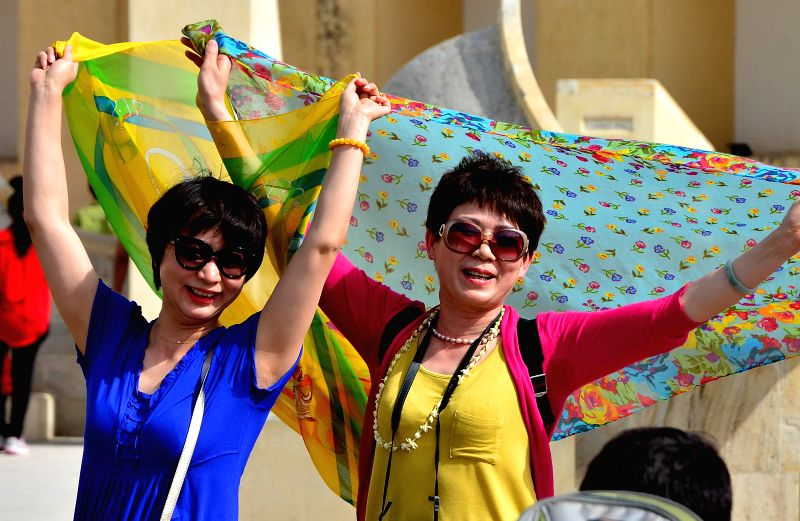 Tourists at Jantar Mantar on a hot day in Jaipur on May 18, 2014.