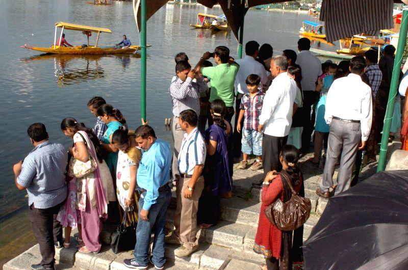 Tourists crowd around the banks of Srinagar's Dal Lake.