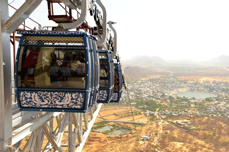 Tourists enjoy ropeway ride in Pushkar of Rajasthan on May 9, 2016.