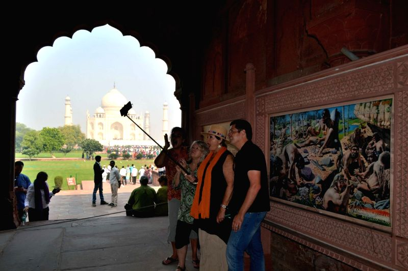 Tourists take a selfie at Taj Mahal on the Day-1 of Heritage Week in Agra, on Nov 19, 2015.