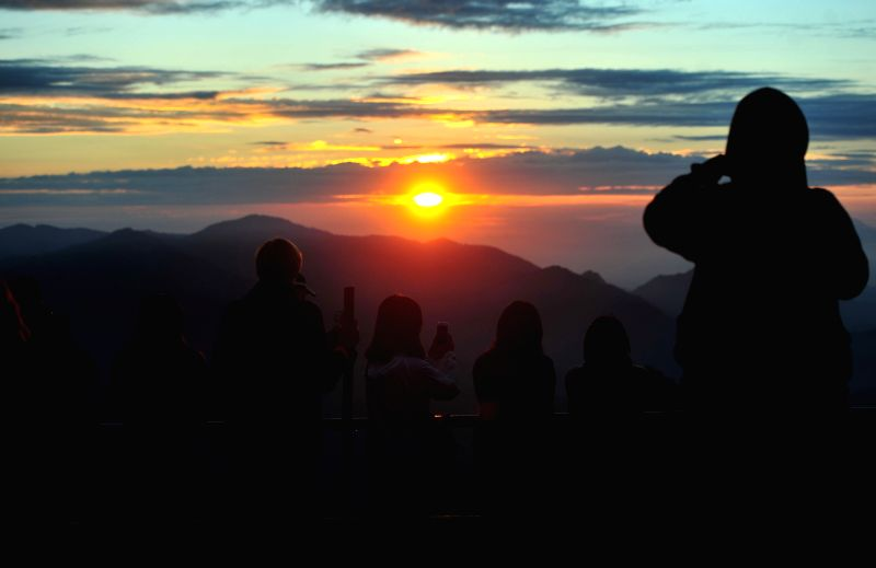 Tourists watch the sunrise from the highest place of Kelimutu volcano at Flores island in East Nusa Tenggara province, Indonesia, May 21, 2016. Mount ...