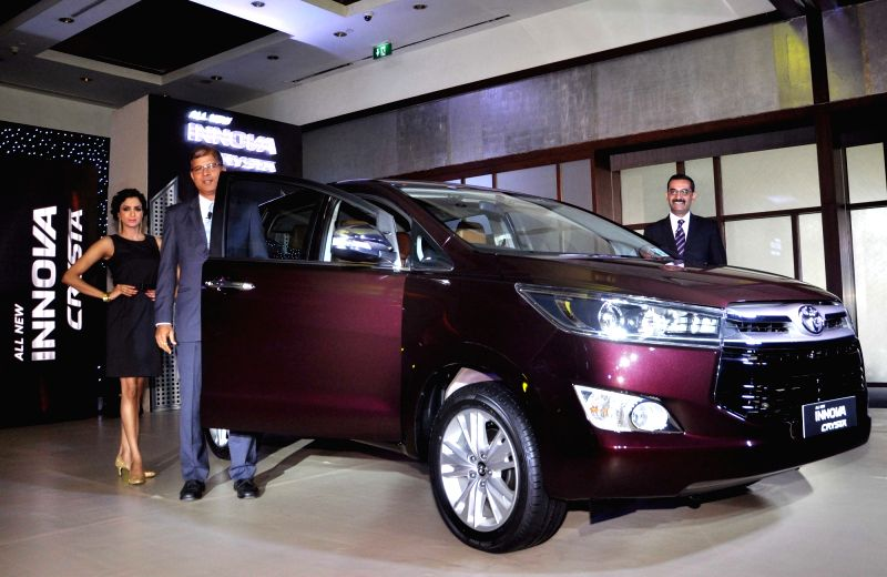 Toyota Kirloskar Motor Vice President Sailesh Shetty and DGM Devendra Puri launch new Innova Crysta in Kolkata, on May 12, 2016. - Sailesh Shetty