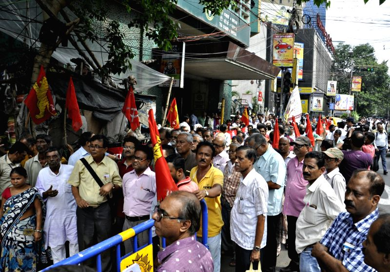 Trade Unions members assemble outside the Tea Board office after the joint forum of trade unions of the tea industry in north Bengal began a two-day industrial strike, demanding ...