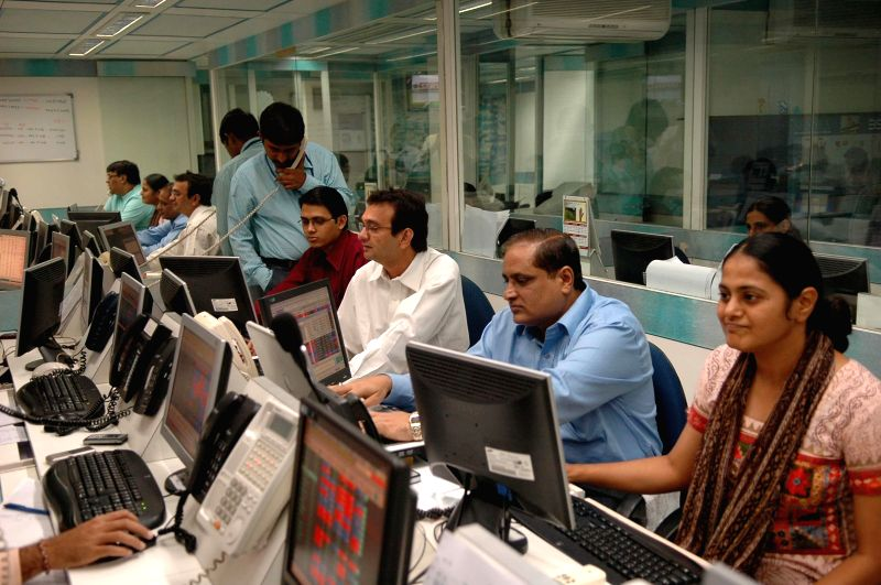 Traders have a nice time as BSE Sensex surges to hit new record high of 23,572.88 points, ahead of the exit poll results in Mumbai on May 12, 2014.