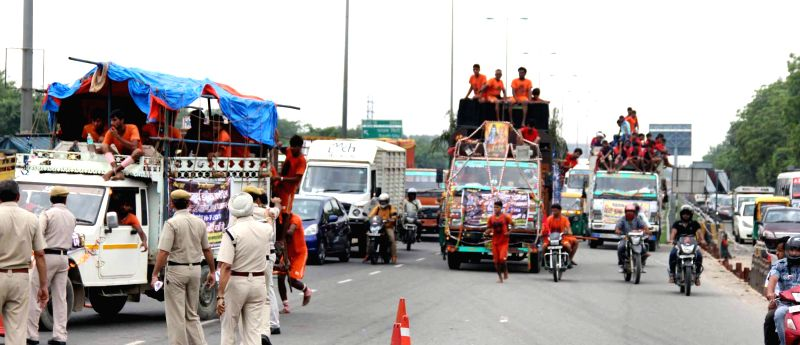 Traffic comes to halt at Delhi-Gurgaon expressway following crossing of Lord Shiva`s devotees in Gurgaon on July 24, 2014.