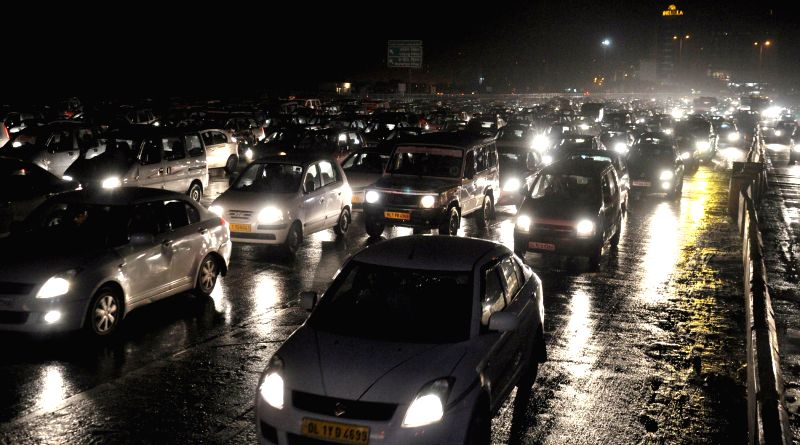 Traffic moves at snail's speed on Delhi-Gurgaon expressway as NCR witnessed strong gusts and downpour after a hot afternoon on May 8, 2014.