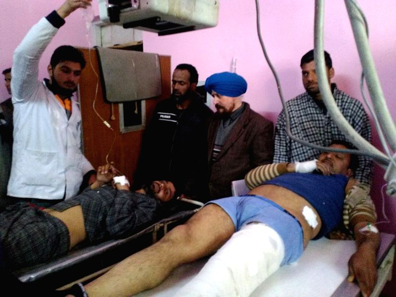 :Tral: One of the four persons injured during a grenade attack being treated at a hospital in Tral town of South Kashmir on Feb 3, 2018. According to police sources, four persons, including two ...