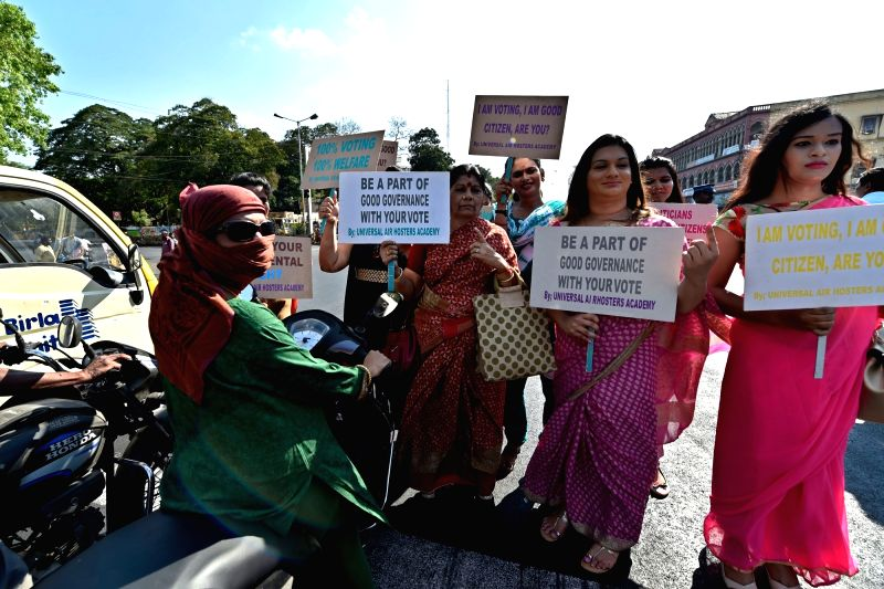Transgenders and students participates during an awareness rally to initiate people 100% vote in the upcoming Tamil Nadu Assembly election, in Chennai on May 14, 2016.