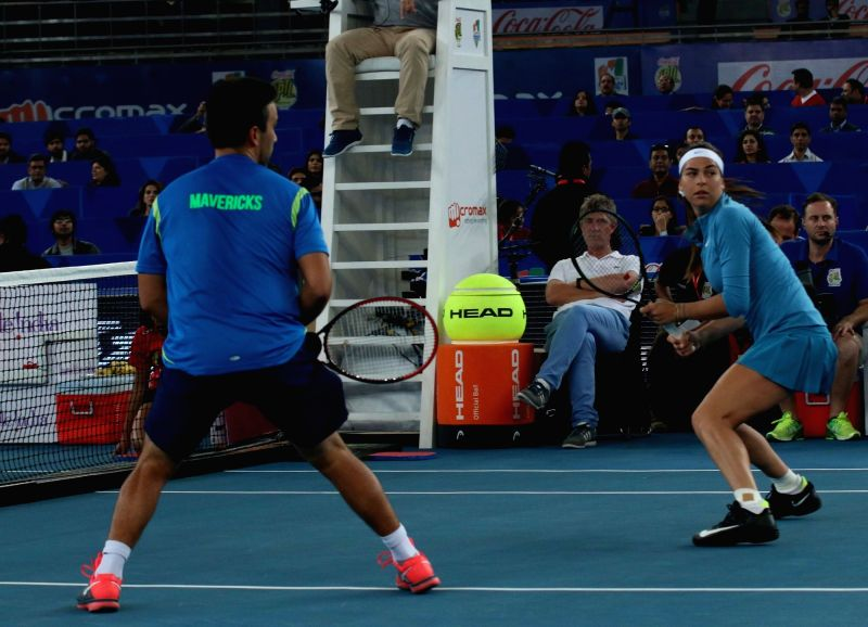Treat Huey and Ajla Tomljanovic during an IPTL match between Micromax Indian Aces and Philippine Mavericks at Indira Gandhi Stadium in New Delhi, on Dec 10, 2015. - Indira Gandhi Stadium