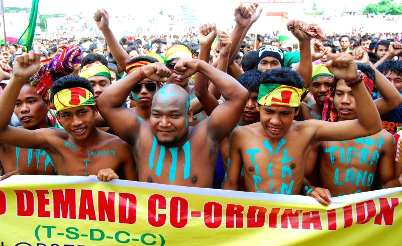 Tribal youths under the banner of 'Twipra land statehood demand co-ordination committee' stages a rally demanding separate state for indigenous people of Tripura in capital Agartala on August 23,