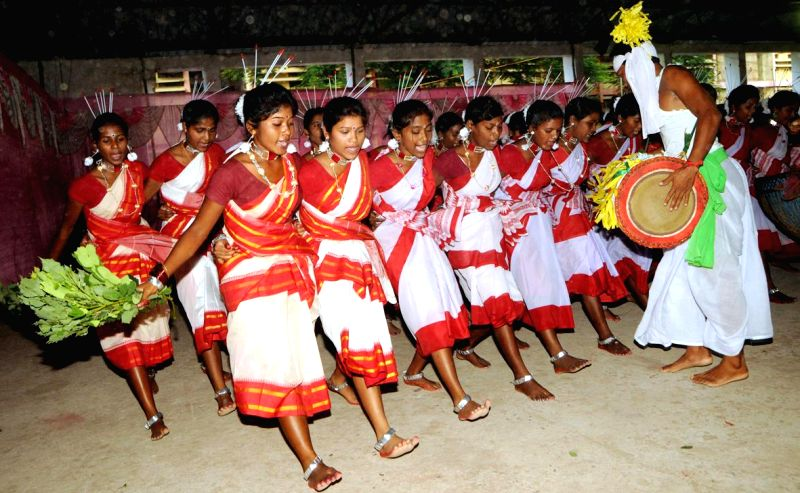 Tribals dance on the beats of 'Mandar' on the eve of `Karma` festival at Ranchi University Auditorium in Ranchi on Sept 4, 2014.