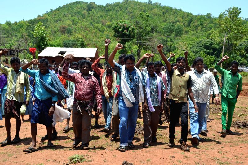 Tribals participate in a rally organised by Khandual Mali Shanti Surakhya Committee (KSSC) against mining in the area at Kanchanmuin village around 35 kms away from Vedanta plant in Lanjigarh block ..