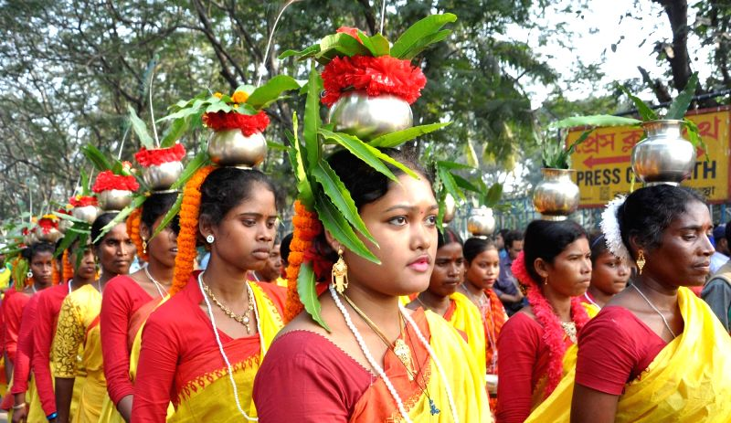 Tribals participate in a rally organised on International Human Rights Day in Kolkata, on Dec 10, 2015.