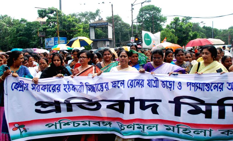 Trinamool Congress activists demonstrate against rail tariff hike in Kolkata on June 27, 2014.