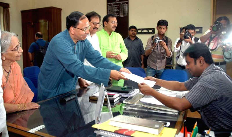 Trinamool Congress candidate for 2014 Lok Sabha Election from Jadavpur parliamentary constituency, Sugato Basu files his nomination papers in Kolkata on April 23, 2014.