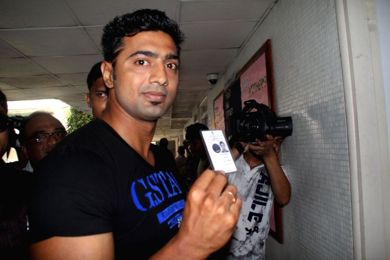 Trinamool Congress candidate for 2014 Lok Sabha Election from Ghatal constituency, actor Dev arrives to cast his vote at a polling booth during the ninth phase of 2014 Lok Sabha Polls in Kolkata on ..