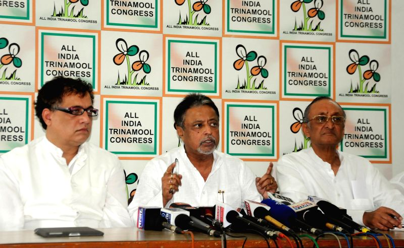 Trinamool Congress General Secretary Mukul Roy with party's spokespersons Derek O`Brien and Amit Mitra during a press conference in Kolkata on April 28, 2014.