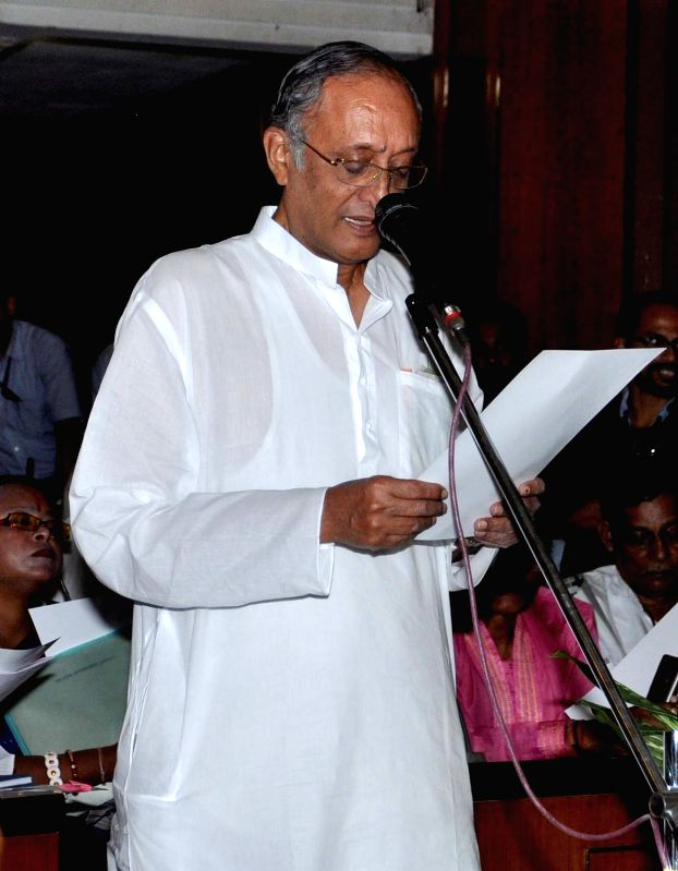 Trinamool Congress leader Amit Mitra takes oath as a legislator at the West Bengal Assembly in Kolkata, on May 28, 2016.