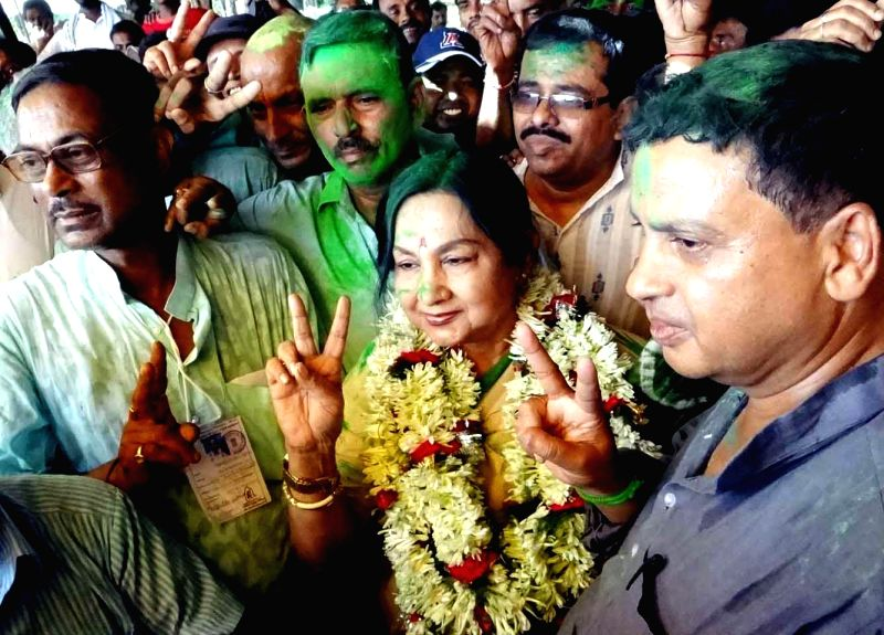 Trinamool Congress leader and actress Sandhya Roy celebrates after winning Medinipur Lok Sabha seat of West Bengal in Midnapore on May 16, 2014.
