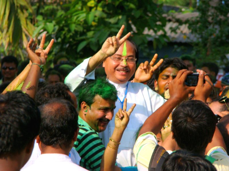 Trinamool Congress leader and Bijoy Chandra Barman celebrates after winning Jalpaiguri Lok Sabha seat of West Bengal in Jalpaiguri on May 16, 2014.