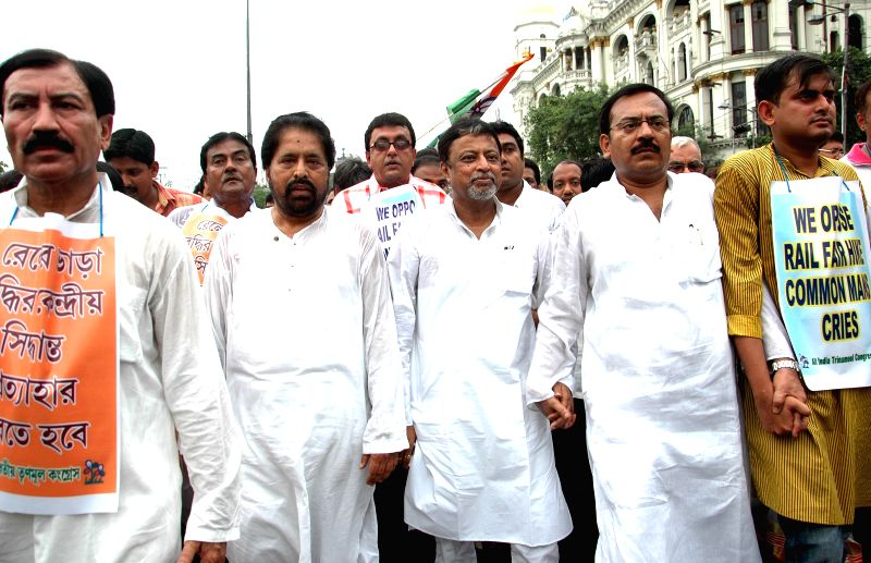 Trinamool Congress leader Sudip Bandopadhyay, Trinamool national general secretary Mukul Roy and other party leaders demonstrate against rail tariff hike in Kolkata on June 23, 2014. - Mukul Roy
