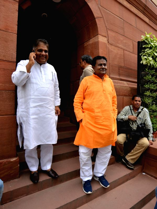 Trinamool Congress MP Idris Ali with BJP MP Bhupender Yadav at Parliament in New Delhi on Aug 3, 2018. - Bhupender Yadav
