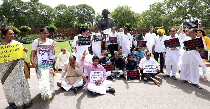Trinamool Congress MPs demonstrate in the Parliament premises against Rail budget 2014-15 in New Delhi on July 9, 2014.