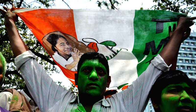 Trinamool Congress supporters celebrate as 2014 Lok Sabha Election - Counting is underway and the party is leading in the state,  in Kolkata on May 16, 2014.