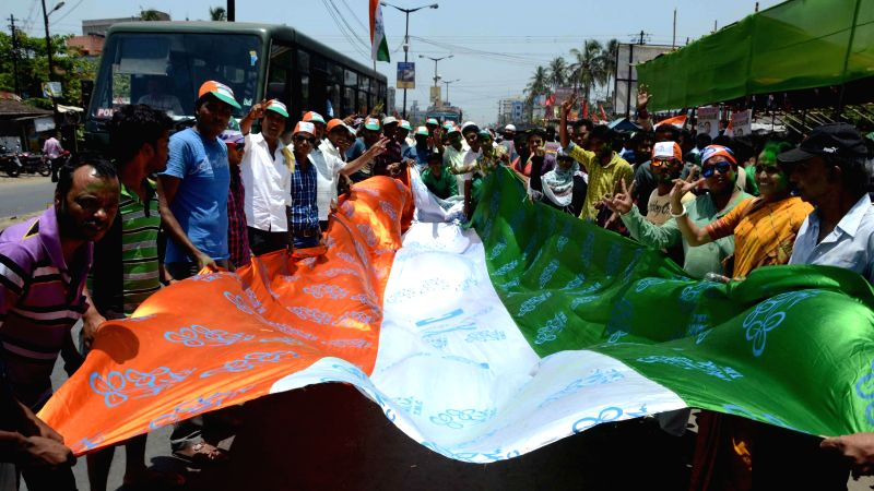 Trinamool Congress supporters celebrate as 2014 Lok Sabha Election - Counting is underway and the party is leading in the state,  in North 24 Parganas district of West Bengal on May 16, 2014.