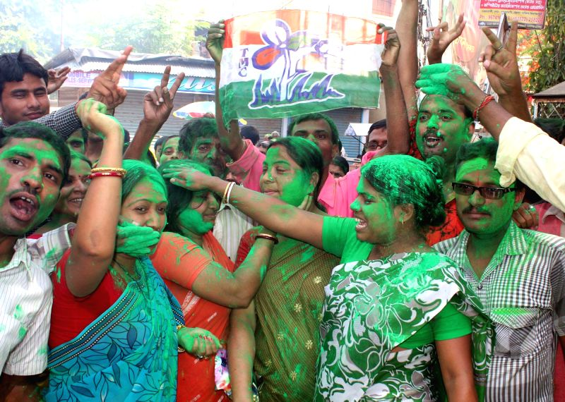 Trinamool Congress supporters celebrate party's performance in 2014 Lok Sabha Polls, in Balurghat of West Bengal on May 16, 2014.
