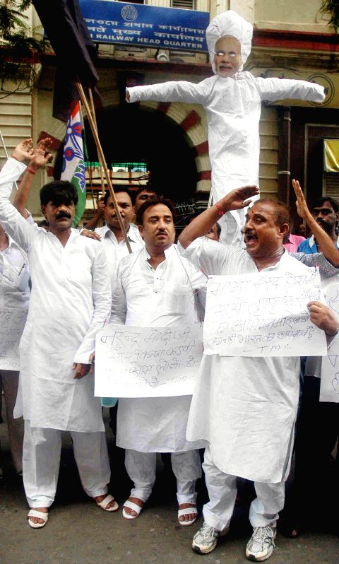 Trinamool Congress (TMC) workers demonstrate against Rail budget 2014-15 in Kolkata on July 9, 2014.