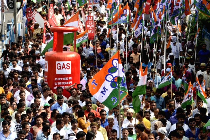 Trinamool Congress (TMC) workers stage a demonstration against fuel price hike, in Kolkata on June 6, 2018.