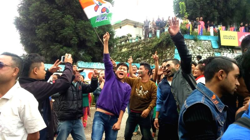 Trinamool Congress workers celebrate their performance in recently held civic body polls in Kalimpong on May 17, 2017.