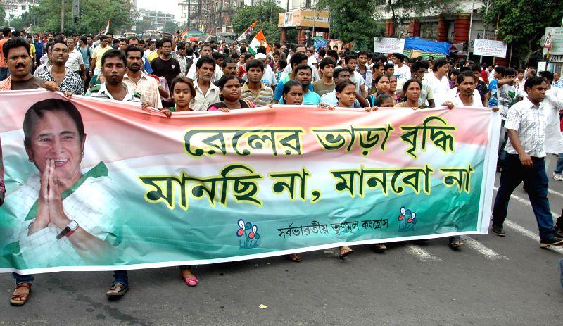 Trinamool Congress workers demonstrate against rail tariff hike in Kolkata on June 23, 2014.