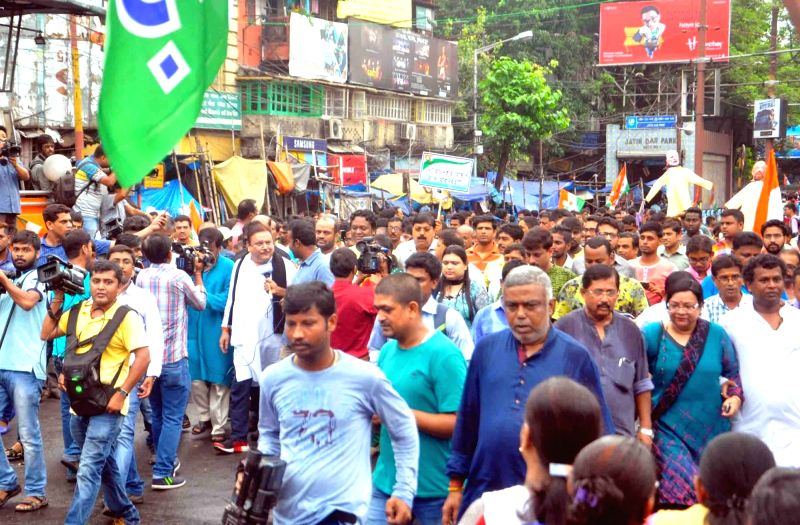 Trinamool Congress workers stage a demonstration against BJP in Kolkata, on Oct 7, 2017.