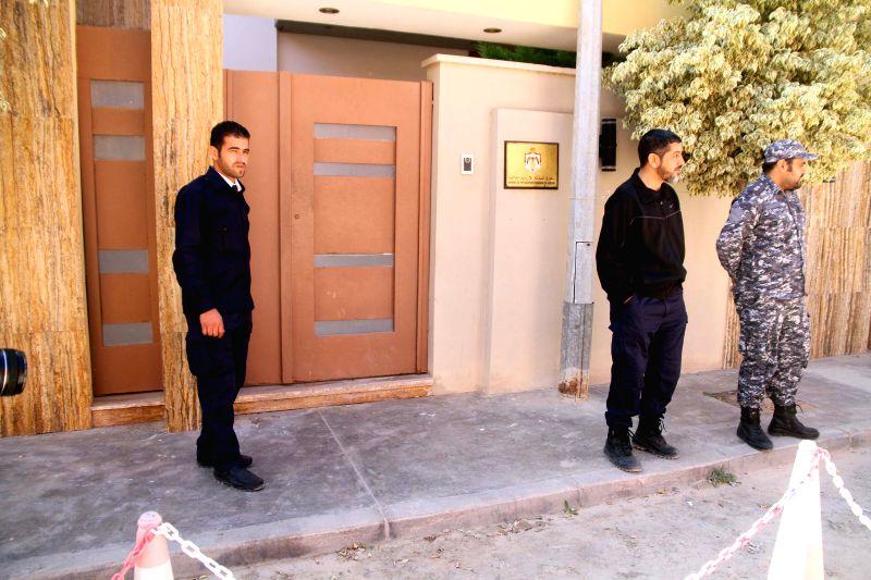 Security guards stand outside the Jordan embassy to Libya, in Tripoli, Libya, on April 15, 2014. Unknown gunmen in Tripoli kidnapped Jordan's ambassador to Libya ..