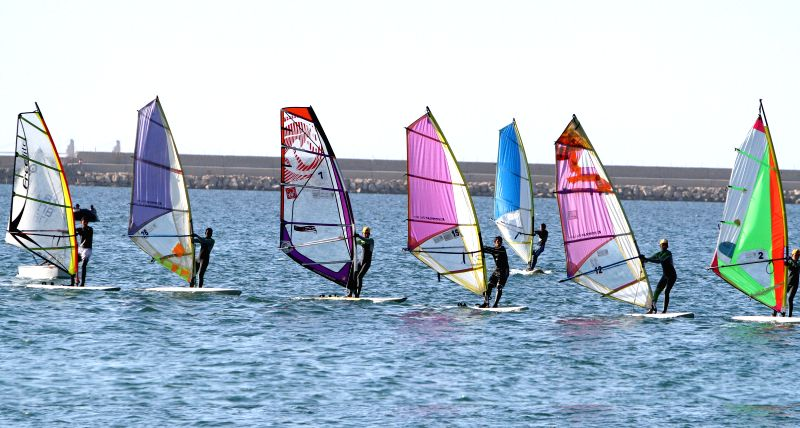 Sailors compete at a harbor during Tripoli Open sailing race in Libya, on April 19, 2014.