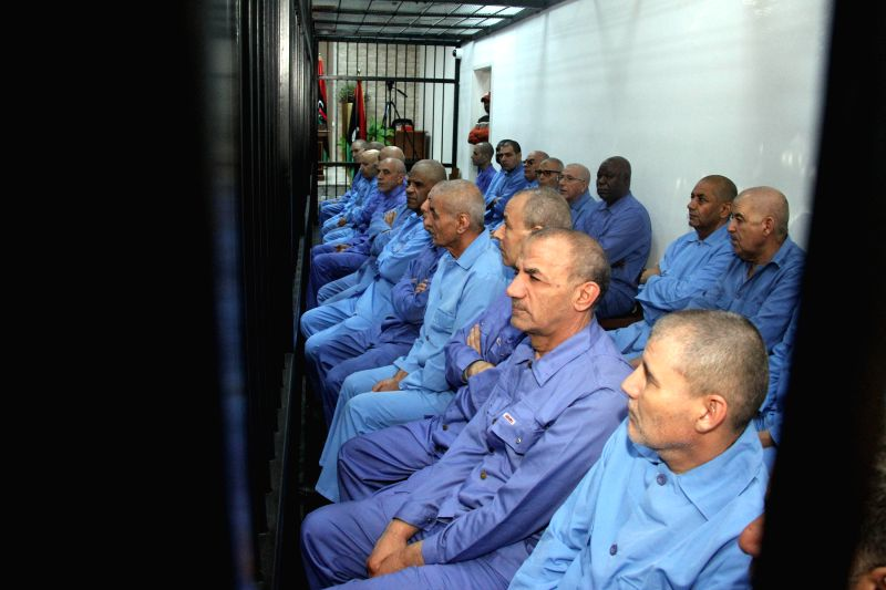 Former Libyan government officials are seen in an appeals court in Tripoli, capital of Libya, on April 20. The court on Monday adjourned until May 3 the trial of ...
