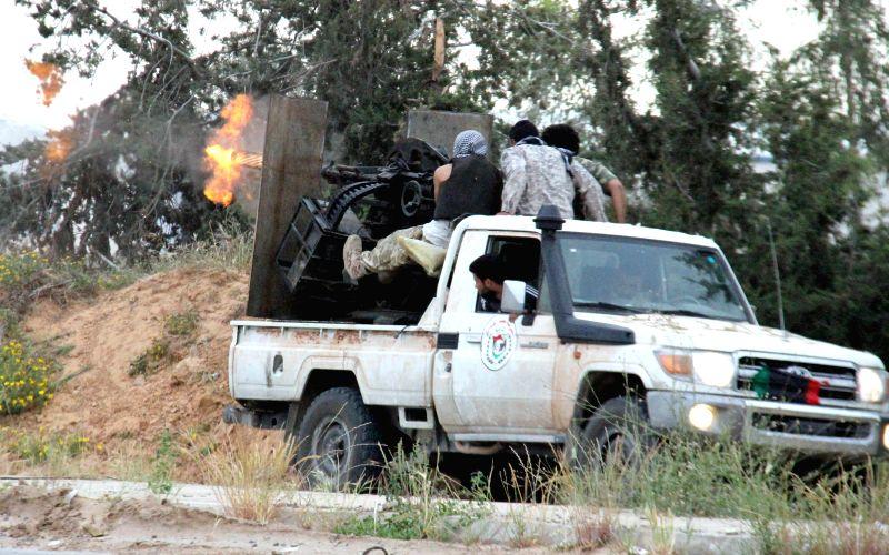 A Libya Dawn fighter fires as heavy fighting goes on in Wershefana region of Tripoli, Libya, on April 22, 2015. Fierce fighting between Libya Dawn militias and ...