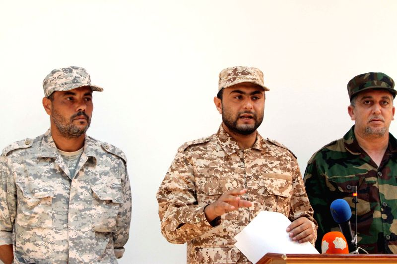 Mohammed Ghiryani (C), spokesman of the Islamic militias who surrounded the Tripoli International Airport, speaks during a news conference, confirming the ...