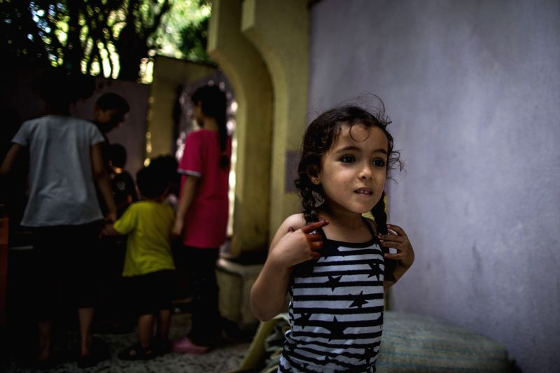 TRIPOLI, Aug. 10, 2019 (Xinhua) -- A displaced girl is seen in an abandoned dispensary in Tripoli, Libya, on Aug 10, 2019. According to the United Nations Higher Commission of Refugees (UNHCR), armed conflict in the Libyan capital Tripoli has displac