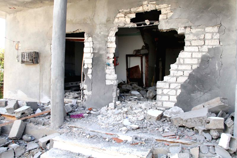 Photo taken on Aug. 11, 2014 shows the damage of a house, following clashes between rival militias in the Warshefana district, west of Tripoli, Libya. Clashes ...