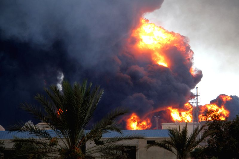 Heavy smoke rises from an oil depot hit by shells during a fighting between Libyan rival militias in Tripoli, Libya, Aug. 2, 2014. The battle for the control of the .
